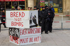 Police cordon and signs banners on protest rally anti-NATO demo Royalty Free Stock Photography
