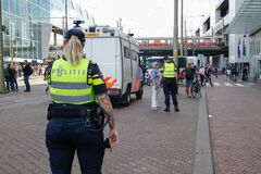 Police cordoning off area to stop people protesting on the streets against lockdown measures by the dutch government in the city
