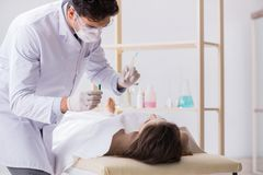 The police coroner examining dead body corpse in morgue. Police coroner examining dead body corpse in morgue royalty free stock photography