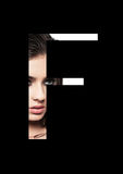 Police créative de mode de fille de maquillage de beauté de lettre de F Images stock