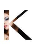 Police créative de mode de fille de maquillage de beauté de lettre de K Photographie stock libre de droits