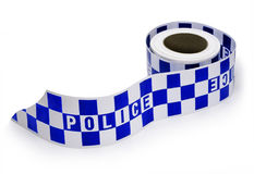 Police Crime Scene Tape. A roll of police crime scene tape isolated on white Stock Images