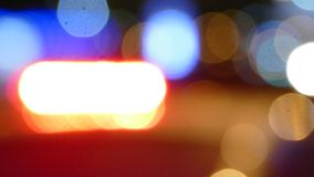 Police cruiser flashing siren lights