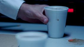 Police Custody Interview Room - Coffee Cup Placed onto Table. Police custody interview room, a messy foam coffee cup is placed on the table for the suspect stock footage