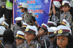 Police Day in Indonesia. Kindergarten student wearing a police uniform during the commemoration of Police Day in Surakarta, Indonesia stock images