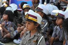 Police Day in Indonesia. Kindergarten student wearing a police uniform during the commemoration of Police Day in Surakarta, Indonesia royalty free stock photos