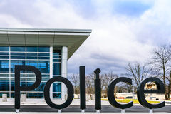 Police Department. Modern police department building with sign in front Stock Images