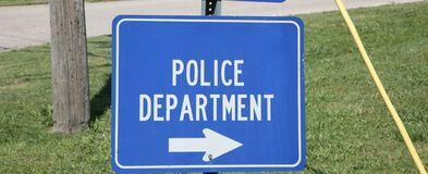 Police Department. A sign directs civilians to the local police department Stock Photos