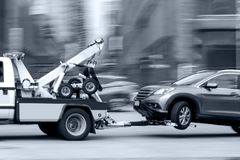 Tow truck delivers the damaged vehicle royalty free stock images