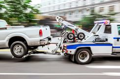 Tow truck delivers the damaged vehicle royalty free stock photos