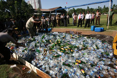 Police destroy illegal liquor Stock Photo