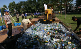 Police destroy illegal liquor Stock Photography