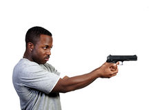 Police Detective. A black African American police detective man on the job with a gun royalty free stock photos