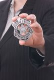 Police detectives badge. Police detective showing her badge stock images