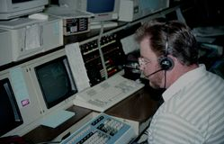 A police dispatcher dispatches to police cars stock photo