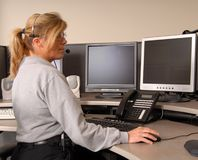 Police dispatcher working. A police dispatcher working at console Stock Images