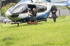 Police dog coming out Police Helicopter Stock Photos