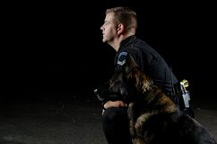 Police Dog. A police dog and his handler looking away Stock Photos