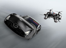 Police drone chasing black car for speed over Stock Photo