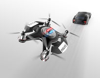 Police drone chasing black car for speed over Stock Photos