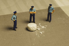 Police and drugs. Mini people Police and drugs Royalty Free Stock Images