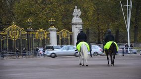 Police on duty near Buckingham Palace stock video footage