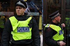 Police on Duty during Riots in London. Police on duty in central London after having come under attack by a breakaway group of protesters during an anti-cuts Royalty Free Stock Photos