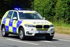 Police Escort BMW car on road Stock Photos