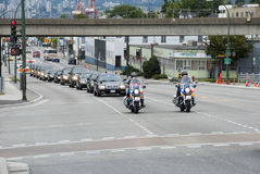 Police Escort. Group of VIP's being escorted by police through streets of Vancouver Stock Photo