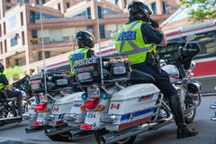 Police escorts on motorbikes oversees the order Stock Photos