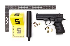 Evidence of handgun with illegal hand made silencer. Police evidence of handgun with illegal silencer and ammunition royalty free stock photography