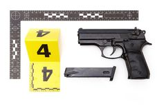 Evidence of handgun with magazine from crime scene. Police evidence of handgun with illegal silencer and ammunition royalty free stock photography