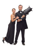 Police film metaphor. Cinema metaphor woman and man posing james bond like with spotlight instead of a gun Stock Photo