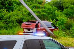 Police cars lights the street after car crash Selective focus. Police flashing blue and red lights the street after damaged car crash Selective focus royalty free stock images