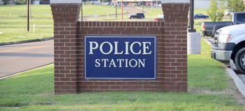 Police Force Station. A police force is a constituted body of persons empowered by the state to enforce the law, protect property, and limit civil disorder.Their Stock Photo