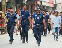 Police force walking in the road in Bangladesh. Some of the police officers are walking together in a road unique editorial photo stock photo