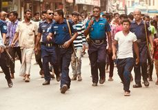 Police force walking in the road in Bangladesh stock photo