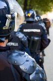 Police forces. Special police forces cordon at the demonstration blocking street protests royalty free stock image