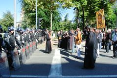 Police forces in the center of Belgrade and members of the clergy Royalty Free Stock Photo