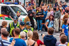 Police forces ensuring safety during the Pride parade on Gedimino street full of people. Event celebrating lesbian, gay, bisexual. Vilnius, Lithuania - July 27 stock image