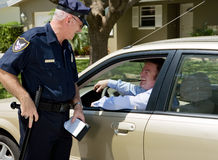 Police - Friendly Traffic Stop. Police officer having a laugh with the guy he just pulled over Stock Images