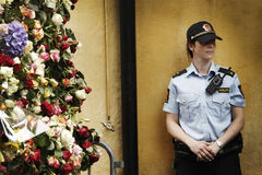 Police in front of gate of flowers stock photography