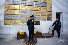 Police in front of signs, Shanghai Royalty Free Stock Image