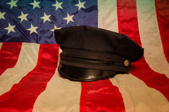 Police Gear. A police hat on an American flag background Stock Images