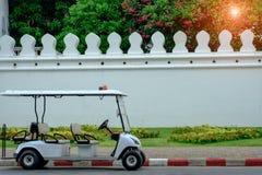 Police golf buggy on street. Stock Image
