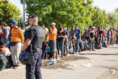 Police guarding the waiting line of Refugees in Tovarnik Royalty Free Stock Images