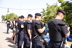 Police guarding the waiting line of Refugees in Tovarnik Stock Image