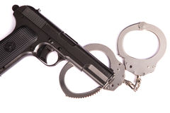 Police handcuffs with a gun isolated Royalty Free Stock Photography