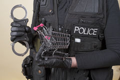 Police handcuffs and a supermarket trolley