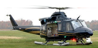 Police helicopter. A police helicopter on the ground stock images